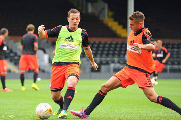 Scottish striker Ross McCormack (left) battles with Alexander Kačaniklić during Fulham FC training session.